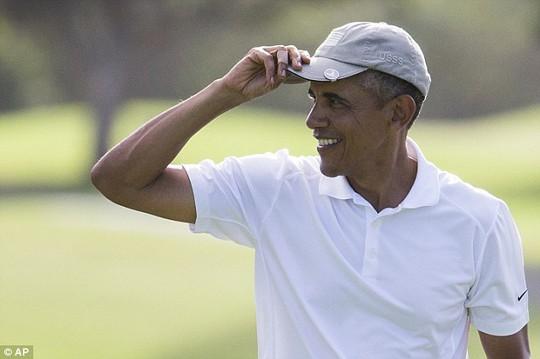 Tổng thống Barack Obama sẽ công bố các quy định mới về sử hữu súng vào tuần tới khi ông trở về từ kỳ nghỉ ở Hawaii. Ảnh: AP