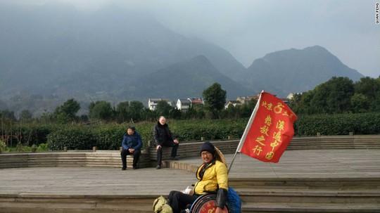 Quan muốn dùng câu chuyện của mình để thay đổi quan niệm về người khuyết tật ở Trung Quốc. Ảnh: CNN