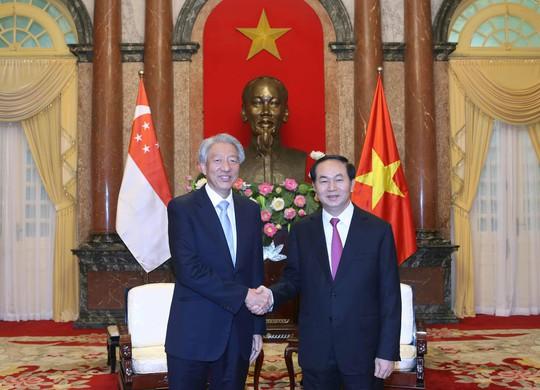 Chủ tịch nước Trần Đại Quang tiếp Phó Thủ tướng Singapore Tiêu Chí Hiền Ảnh: TTXVN