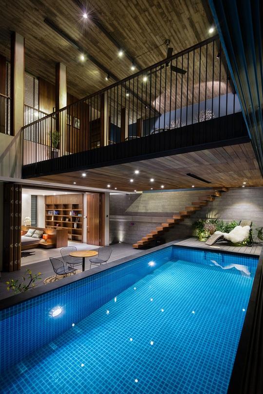 Không gian tầng 2 là phòng khách và bể bơi.