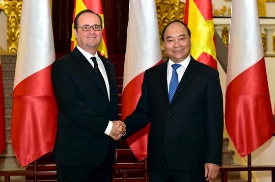 Thủ tướng Nguyễn Xuân Phúc hội kiến Tổng thống Pháp Francois Hollande - Ảnh: Nhật Bắc