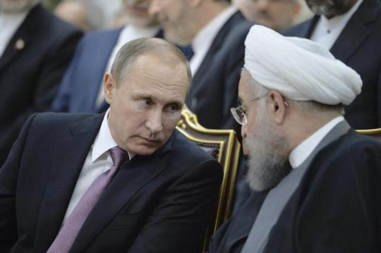 Hai Tổng thống Putin (trái) và Rouhani. Ảnh: Reuters