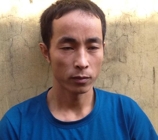 Trần Văn Kháng, nghi can đâm chết anh đồng hao bằng 18 nhát dao, tại cơ quan công an