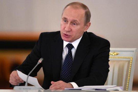 Tổng thống Nga Vladimir Putin cho biết sẵn sàng thảo luận việc chiếc máy bay MH17. Ảnh: Reuters