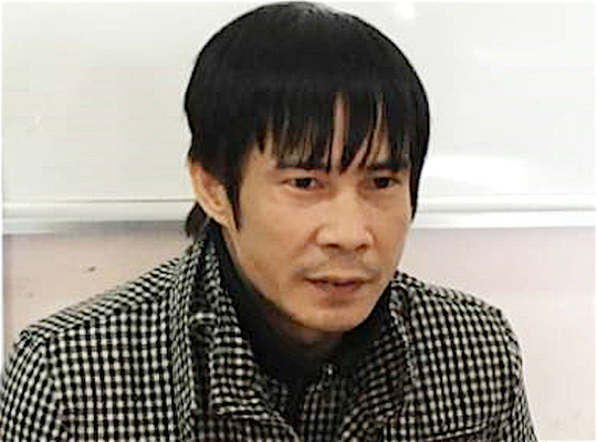 Bị can Nguyễn Quang Vinh tại cơ quan công an