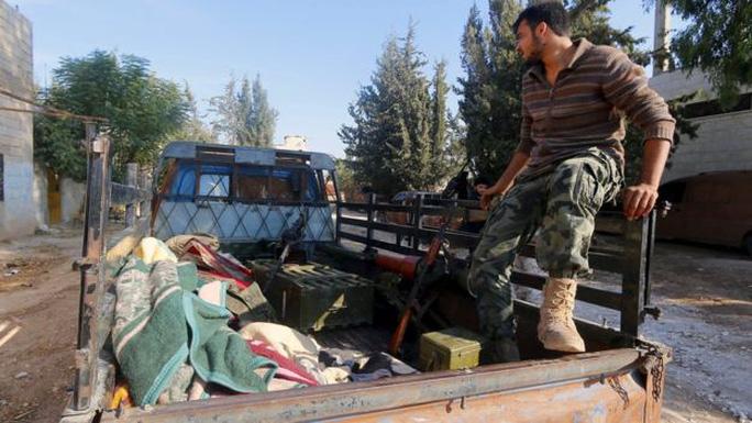 Chiến sự đang nổ ra ở làng Kafr Nabudeh. Ảnh: Reuters