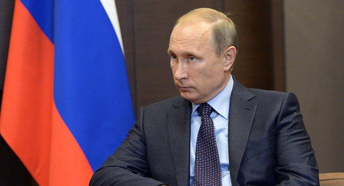 Tổng thống Nga Vladimir Putin phủ nhận sự tham gia của các lực lượng vũ trang Moscow trong chiến dịch quân sự trên bộ tại Syria. Ảnh: Sputnik