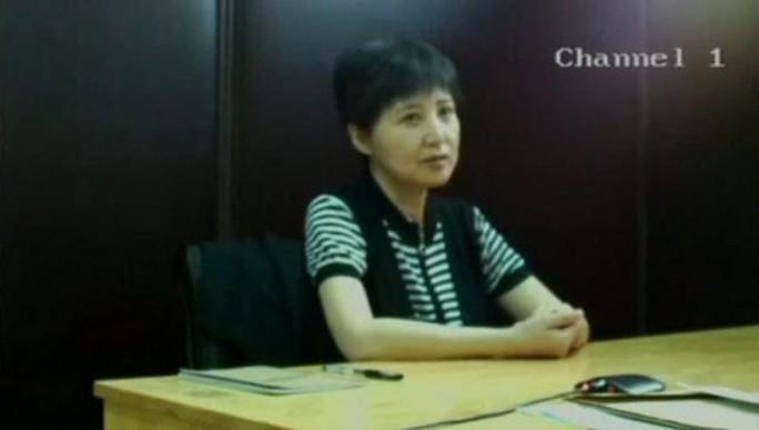 Bà Cốc Khai Lai trong đoạn video được tòa án Tế Nam phát trong phiên xử chồng mình hồi tháng 8-2013. Ảnh: Reuters