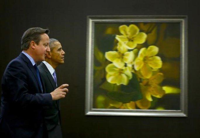 Tổng thống Mỹ và Thủ tướng Anh vừa điện đàm về việc chống IS. Ảnh: Reuters