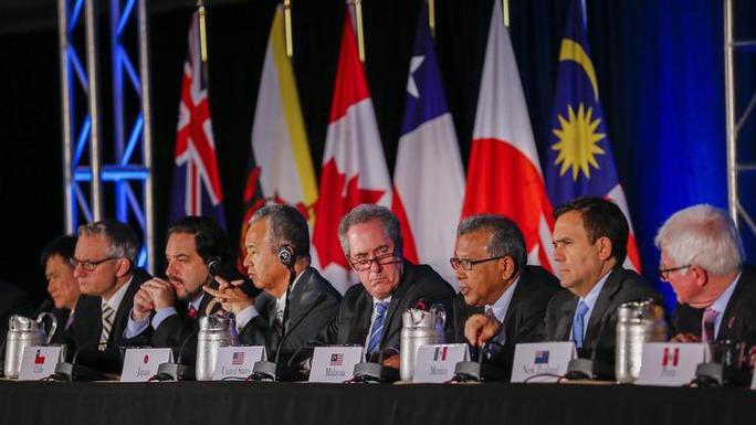Cuộc họp báo công bố đạt được thỏa thuận về Hiệp định Đối tác xuyên Thái Bình Dương (TPP)  hôm 5-10 Ảnh: EPA