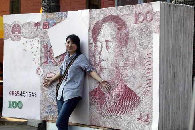 Triều Tiên bị cáo buộc in tiền giả Trung Quốc. Ảnh: UPI