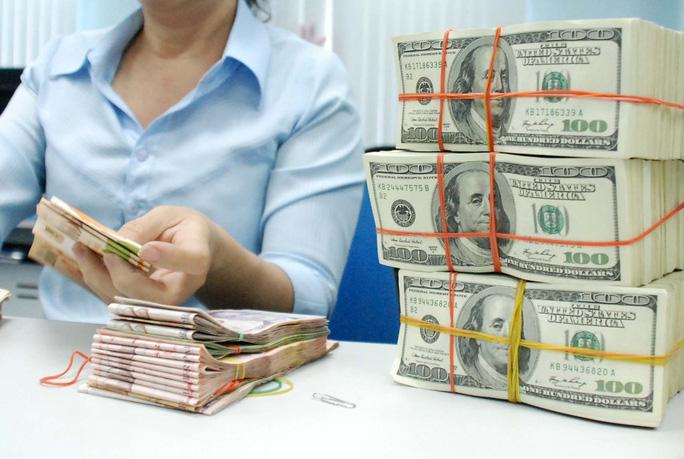 Mua - bán USD kỳ hạn cần thay đổi để doanh nghiệp an tâm giao dịch Ảnh: Tấn Thạnh