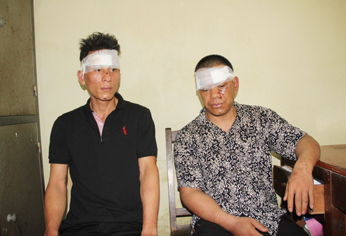 Hai đối tượng Nguyễn Trọng Đại (trái) và Nguyễn Văn Hà tại cơ quan công an