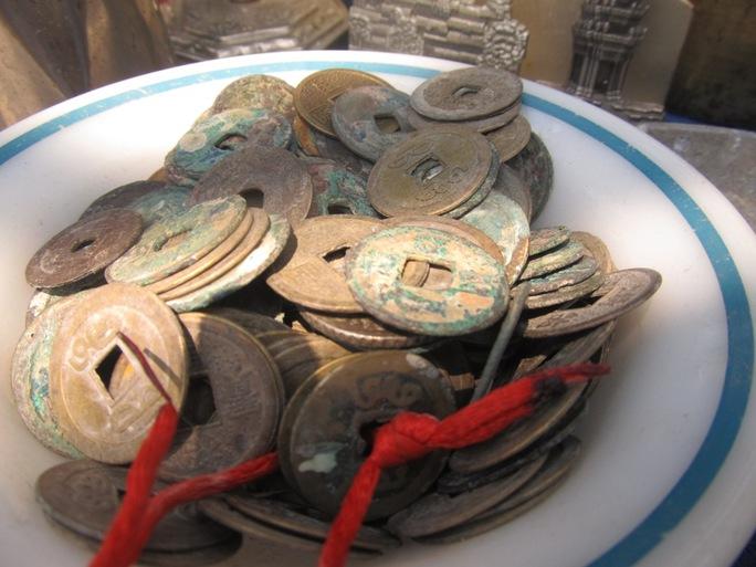 Tiền cổ, món đồ không thể thiếu trong mọi của hàng đồ cổ