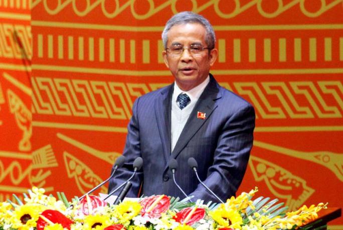 Ủy viên Trung ương Đảng khóa XI, Chủ tịch Tổng Liên đoàn Lao động Việt Nam Đặng Ngọc Tùng trình bày tham luận tại Đại hội XII
