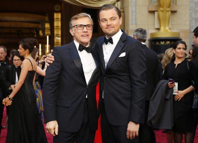 Leonardo và nam diễn viên Christoph Waltz tại Oscar 2014.