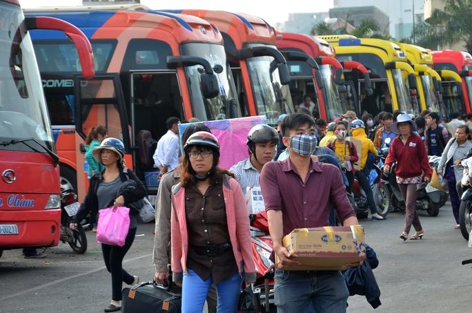 Các doanh nghiệp vận tải hành khách phải công khai giảm cước trong tháng 2 theo yêu cầu của Bộ Giao thông Vận tải Ảnh: Tấn Thạnh