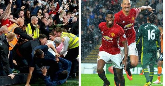 CĐV M.U ăn mừng hỗn loạn trên khán đài sau bàn thắng của Rashford