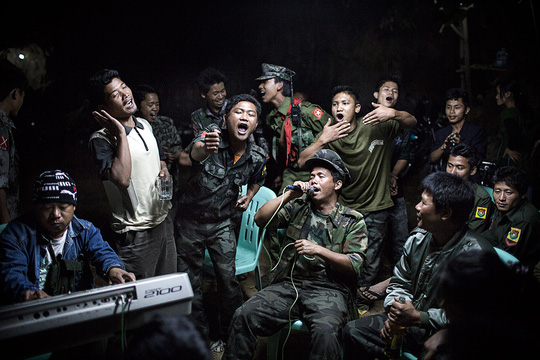 1st Prize Daily Life Single: Julius Schrank. 15 March 2013, Burma. Kachin Independence Army fighters are drinking and celebrating at a funeral of one of their commanders who died the day before. The city is under siege by the Burmese army.