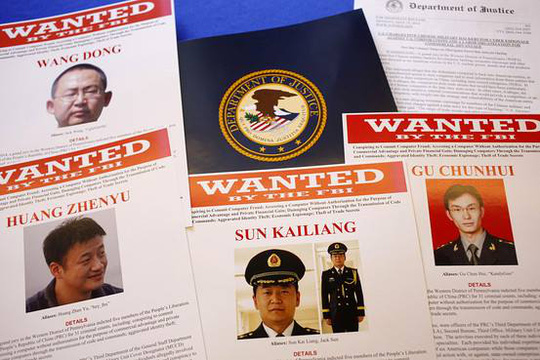 Photo: The U.S. Justice Department announced charges against five individuals in the Chinese military, accusing them of hacking U.S. companies for trade secrets. http://on.wsj.com/1mNGdQ5 Pictured: FBI posters related to the case (Credit: AP)