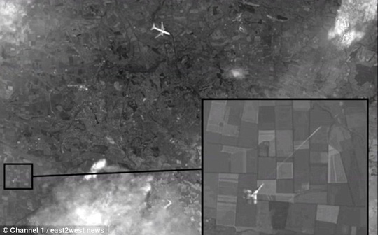 Russian Channel 1 has released satellite images which suggest Malaysian Boeing MH17 (top of picture) was shot down by a Ukrainian warplane (bottom left)