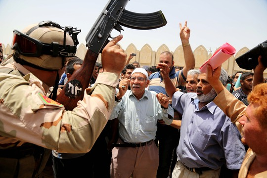 CLICK IMAGE for slideshow: Al-Qaida-inspired insurgents gaining ground in Iraq. (AP Photo/ Karim Kadim)