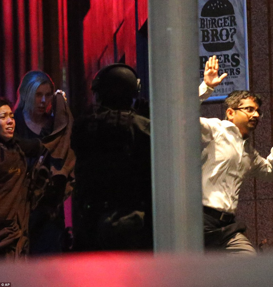 Siege over: Police raided the cafe in central Sydney early Tuesday, bringing a dramatic end to a 17-hour siefe. The raid came moments after some hostages fled the Lindt cafe after more than 16