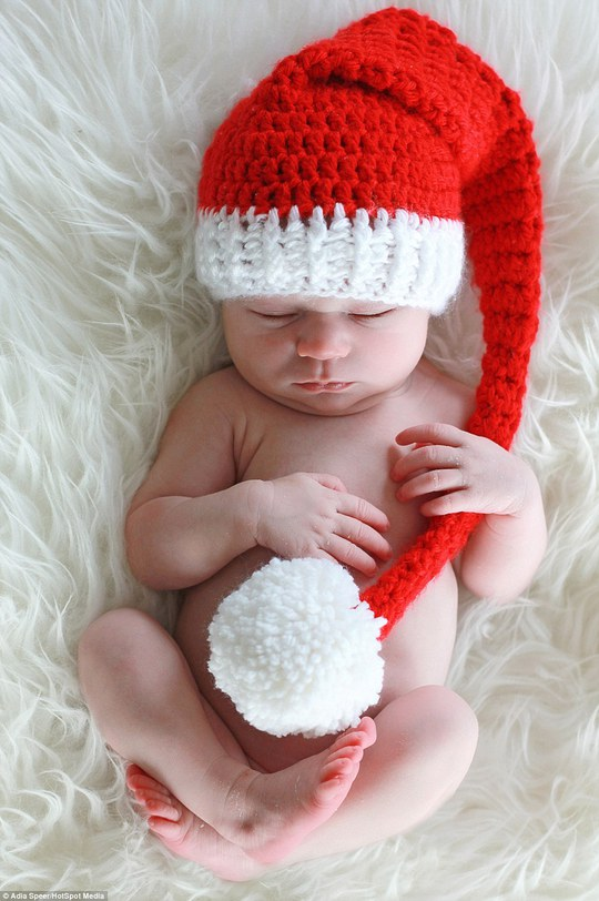 Varying from one to three hours for each photoshoot, Adia photographs the youngsters in Santa hats, munching on Christmas carrots and even posed in a little Christmas baskets. In this picture,Vera, under two weeks old, looks adorable wearing this woolly Santa hat