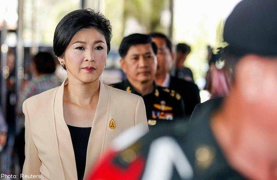 Thủ tướng Yingluck lại đối mặt với thách thức pháp lý mới. Ảnh: Reuters