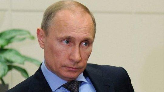 Ông Putin đang thúc đả hoàn tất dự luật sáp nhập Crimea vào Nga trong tuần này. Ảnh: BBC