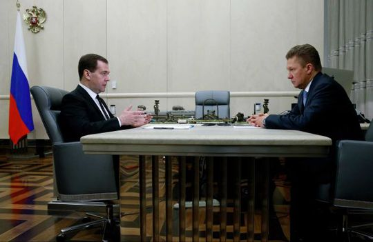 Russian Prime Minister Dmitry Medvedev, left, meets with Gazproms Chief Executive Alexei Miller in Moscow, Russia, Thursday, April 3, 2014. Russian gas giant Gazprom on Thursday urged Ukraine to pay its debt, and announced a 70 percent rise in the charge for future supplies. Photo: Dmitry Astakhov, AP / RIA Novosti Russian Government