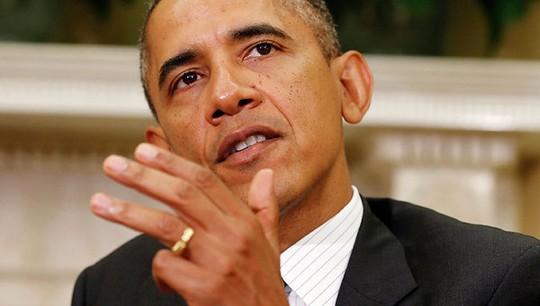 """Tổng thống Mỹ Barack Obama công bố quyết định """"tăng cường và mở rộng"""" các biện pháp trừng phạt Nga. Ảnh: Reuters"""