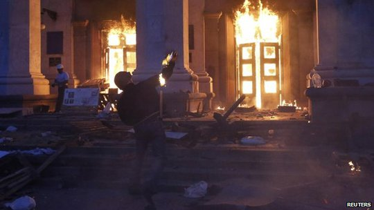 A protester throws a petrol bomb at the trade union building in Odessa on 2 May 2014