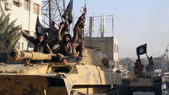 IS militants on top of a tank