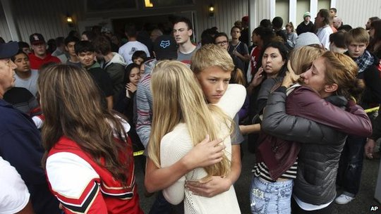 The students embraced after they evacuated the school