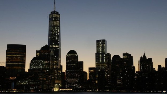 One World Trade Center dominates the lower Manhattan skyline, 3 November 2014 in this view from Jersey City, NJ