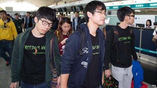 Three Hong Kong student protest leaders at the citys airport