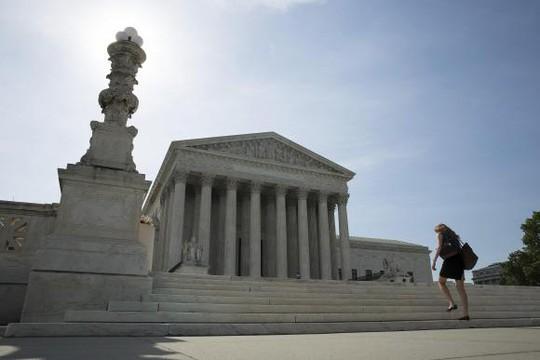 Tòa án tối cao Mỹ ở Washington vừa ra phán quyết hạn chế quyền bổ nhiệm của Tổng thống Obama. Ảnh: Reuters