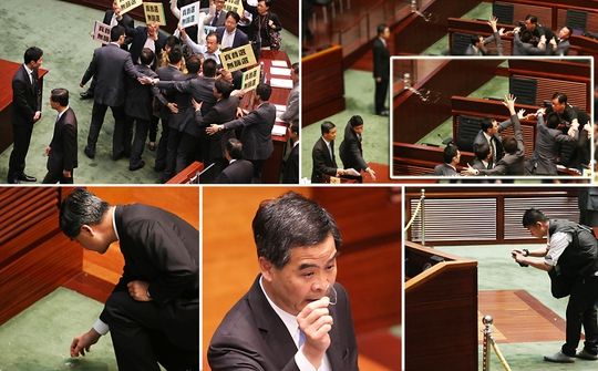 Ông Lương Chấn Anh bị ném ly nước vào người trong cuộc họp Hội đồng lập pháp ngày 3-7. Ảnh: SCMP
