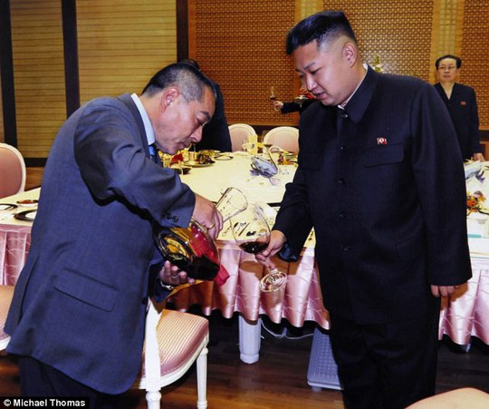 Like old times: Kenji Fujimoto pours wine for Kim Jong Un during their reunion in 2012, burgundy red is not the North Korean dictators favorite, although he used to down bottles of vodka from his early teens