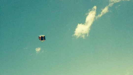 A witness picture of a bounce house blowing through the air in South Glens Falls on Monday, well after children inside had fallen out. Three children were hurt, two seriously. -- PHOTO: POSTSTAR.COM/EMILY BOUCHER