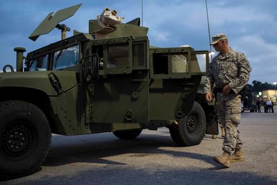 Mỹ phái vệ binh quốc gia tới Ferguson để dẹp loạn. Ảnh: New York Times