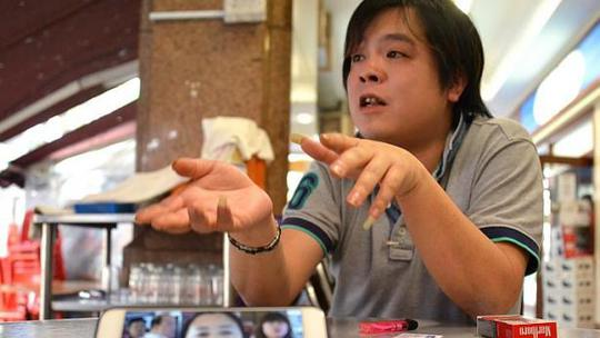 Mobile Airs owner Jover Chew being interviewed by the media. -- PHOTO: THE NEW PAPER