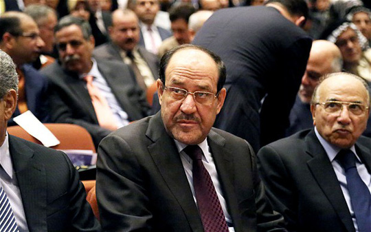Iraqi Prime Minister Nouri al-Maliki (C) attends the first session of parliament on Tuesday in Baghdad, Iraq