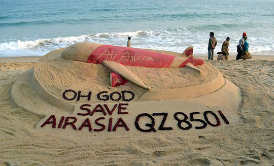 Sand artist Sudarshan Pattnaik makes a sand art to pray for Air Asia Indonesia airliner which went missing on its way to Singapore with 162 people on board at Gopalpur sea beach (Photo: PTI)