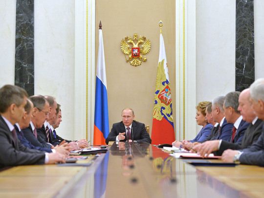 Russian President Vladimir Putin, centre, heads the Security Council in Moscows Kremlin on Friday.