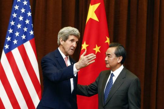 Ngoại trưởng Mỹ John Kerry và Ngoại trưởng Trung Quốc Vương Nghị hôm 14-2 Ảnh: BILD