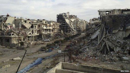 Thành phố Homs giờ chỉ còn lại những đống đổ nát. Ảnh: Reuters