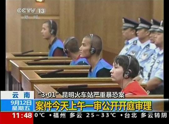 Tòa xét xử các nghi phạm trong vụ tấn công nhà ga ở thành phố Côn Minh. Ảnh: Reuters