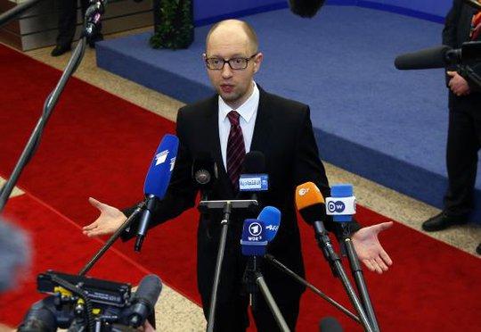 Thủ tướng lâm thời Ukraine Arseniy Yatsenyuk và EU đã ký kết hiệp định liên kết tại Brussels. Ảnh: Reuters